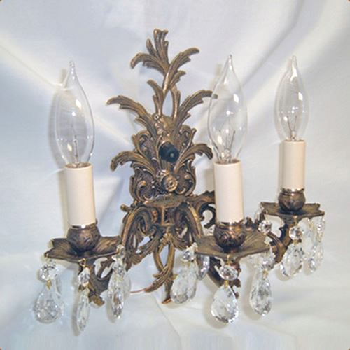 Three-armed cast brass wall sconce