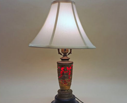 Unusual table lamp with wind-up music box in base