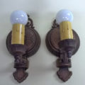 Pair of single-armed cast iron wall sconces