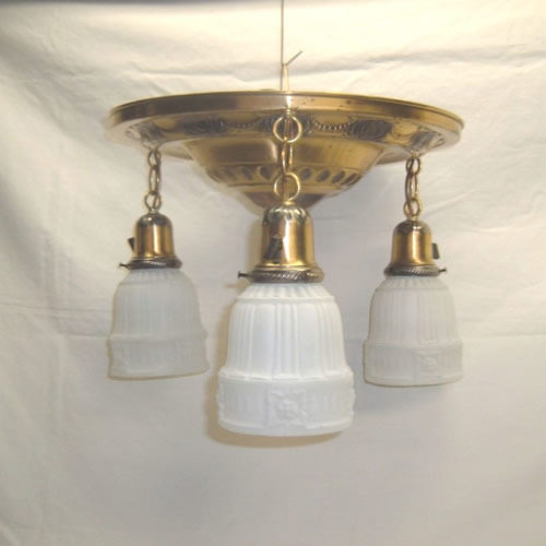 Brass flush mount ceiling fixture with three lights