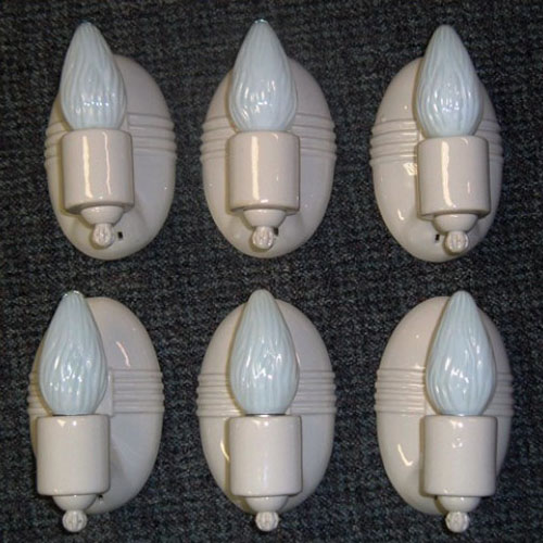 Six matching oval porcelain wall sconces