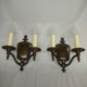 Pair of double-armed brass wall sconces