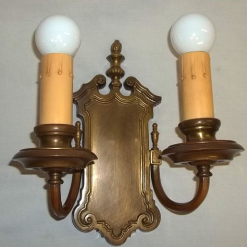 Double-armed cast brass wall sconce