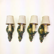 four matching polychrome wall sconces