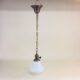 Brass pendant with white opal glass bell shade