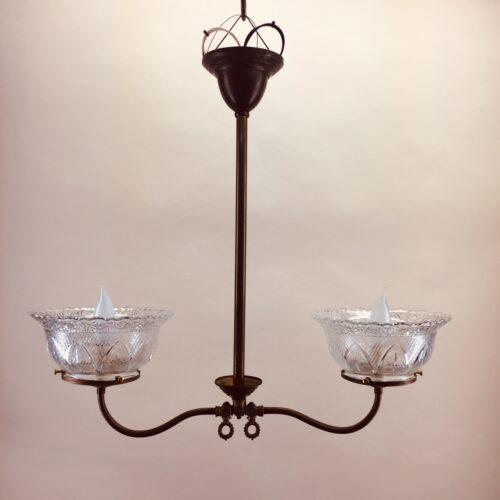 Two-armed brass chandelier, originally gas